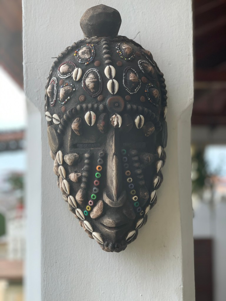 a traditional mask in swahili house in stone town, zanzibar, tanzania by sarah ambitious
